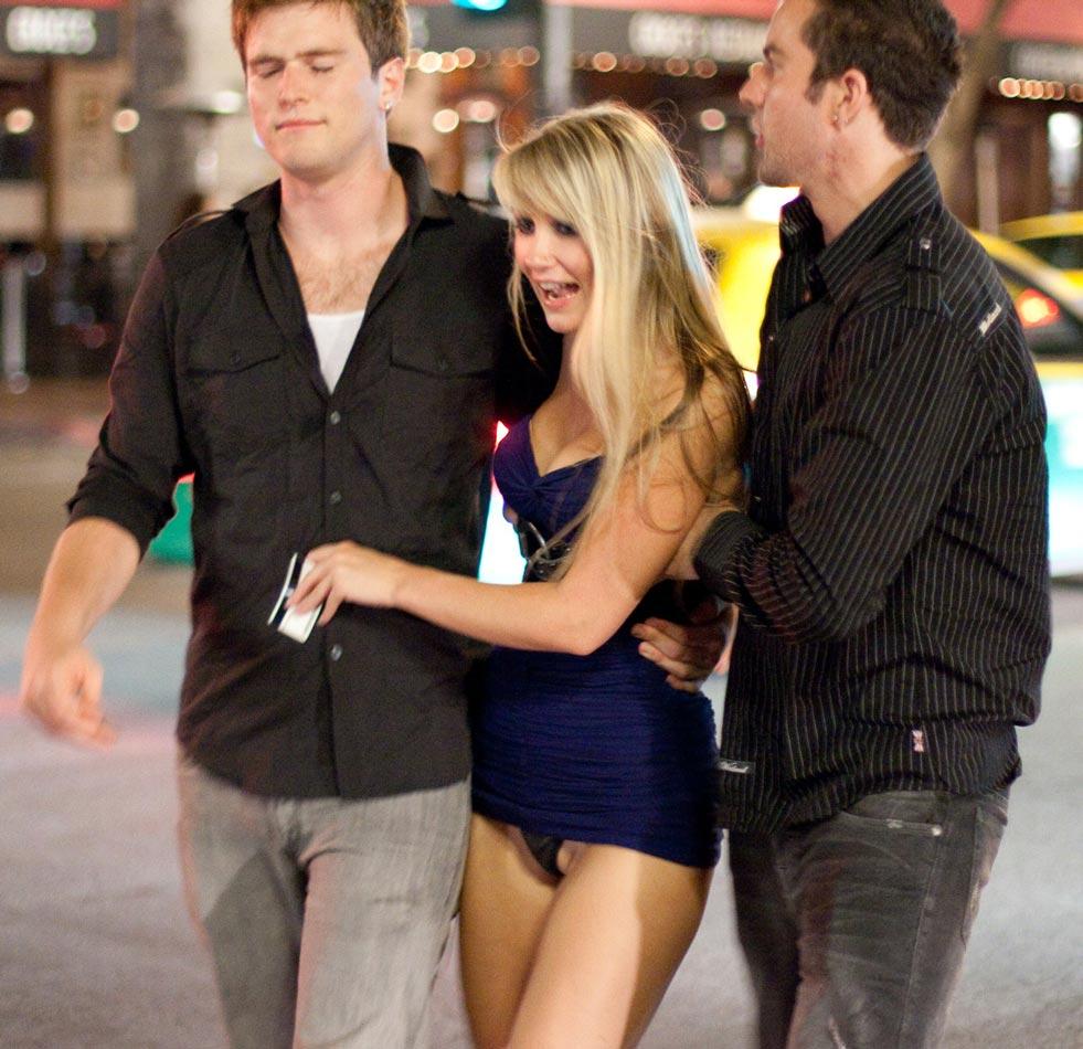 Drunk blonde girl shows thong