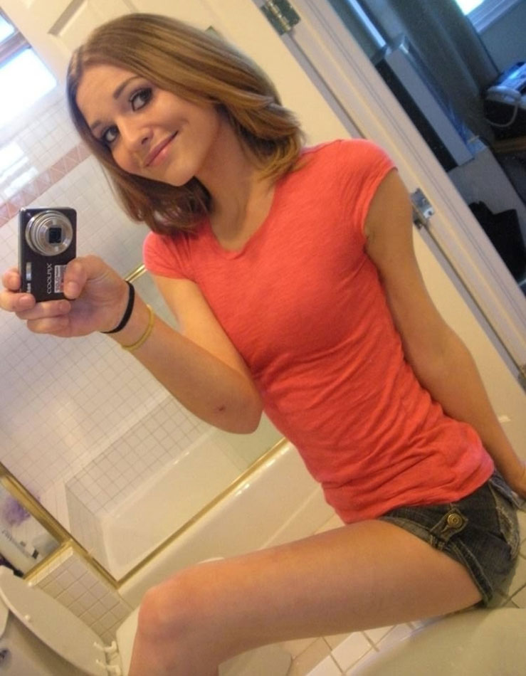 Cute girl taking naughty pictures