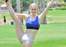 Sporty blonde stripping outdoors