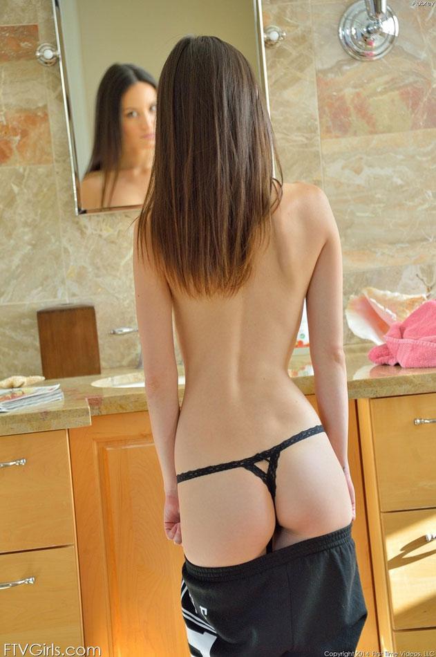 Showing her cute little ass in thong