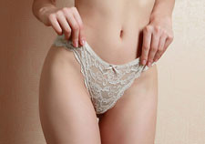 Petite girl in white lace panties