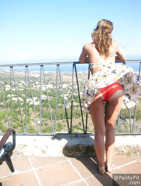 Windy upskirt shows red lace cheeky panties
