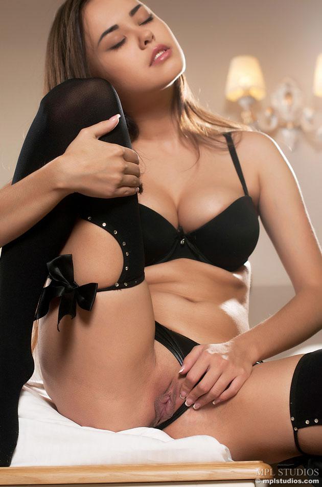 Pulling her panties aside
