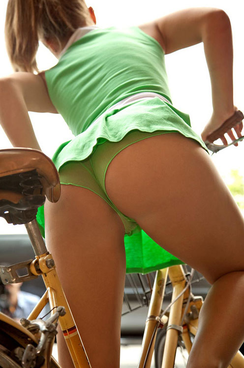 Candid upskirt shot on a bike