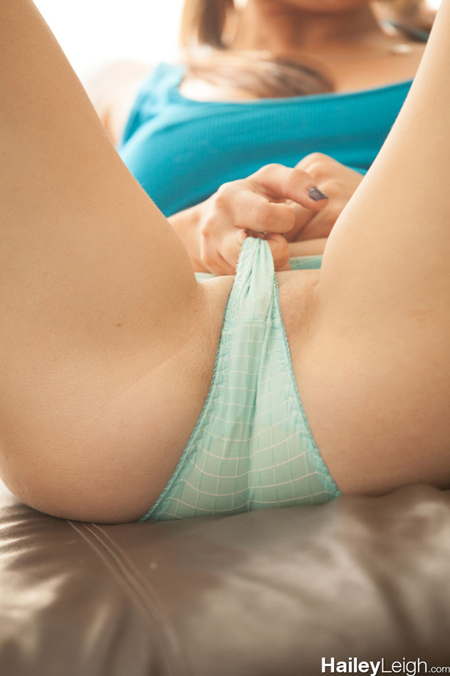 Pulling underwear tight against her pussy
