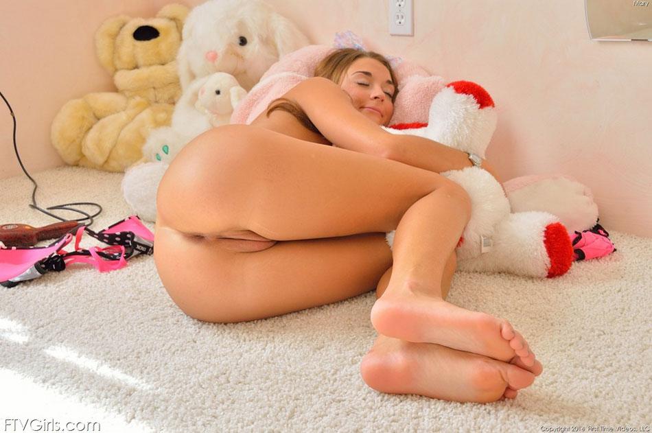 Cute girl naked in bedroom