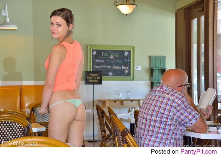 Public tease pic of this cute brunette flashing her ass in a sexy thong